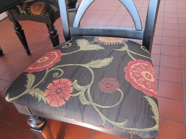 My parents helped me put art nouveau fabric (from a remnant I bought on eBay) on these cheap chairs I bought online.