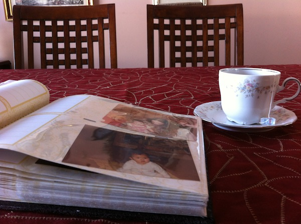 Photo albums with cup of tea