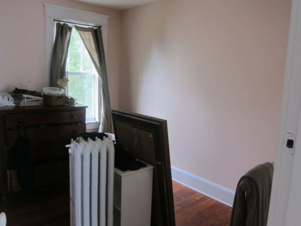 New nursery in shell pink with salvaged decorative radiator.