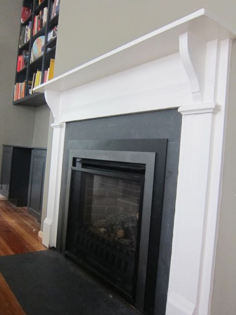 Living room with salvaged fireplace mantel and Benjamin Moore Copley Gray paint on walls