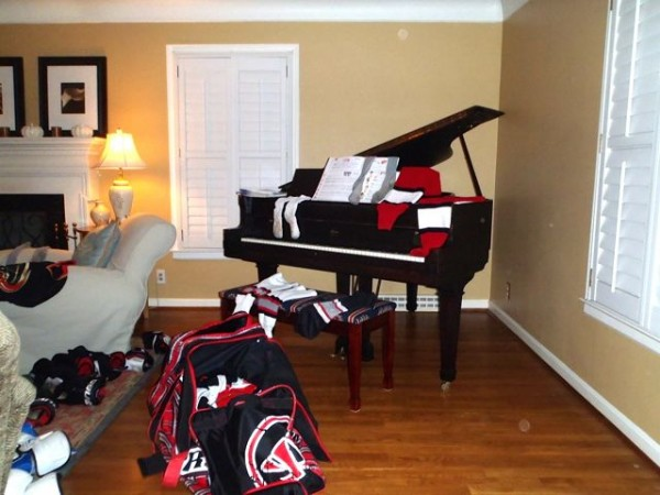 Piano covered with hockey gear
