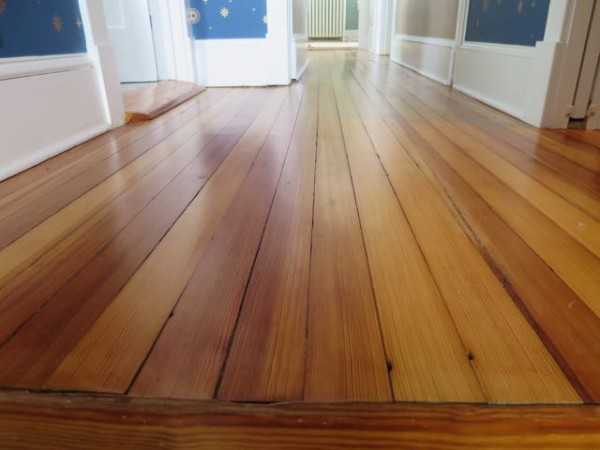 Reclaimed pine flooring was used to match and replace flooring that was destroyed in a renovation