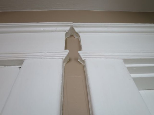 Reclaimed crown molding and other door and window trim is sturdy and has an old-world patina