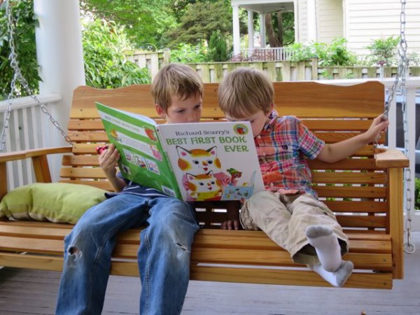 Mark and Luke reading a book on our new porch swing.