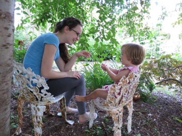 Sofia and Diana on the baby antique chairs under our weeping cherry tree.